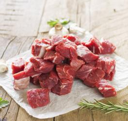 Raw marbled diced beef steak