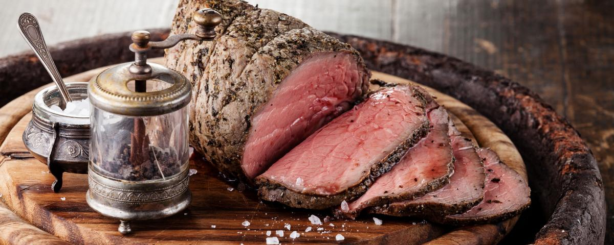 Roast beef joint on a cutting board